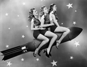 Three women on a rocket representing your brand taking off and being heard.